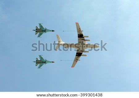 MOSCOW, RUSSIA - MAY 7, 2015:The aircraft tanker Ilyushin Il-78 and Russian multipurpose fighter-bombers Sukhoi Su-34 (Fullback) in the sky over Moscow flies up to Red Square.