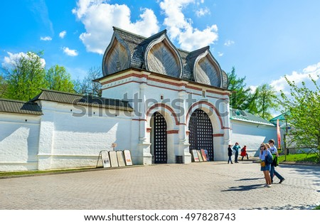 MOSCOW, RUSSIA - MAY 10, 2015: The white Spassky Rear Gate with the figured wooden roof leads to the Kolomenskoye Royal Estate, on May 10 in Moscow.
