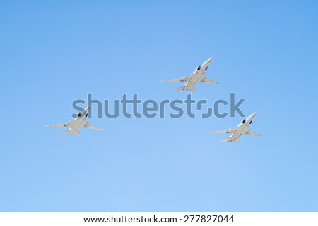 MOSCOW/RUSSIA - MAY 7: 3 Tupolev Tu-22M3 (Backfire) supersonic swing-wing long-range strategic strike bombers fly on parade devoted to 70-th Victory Day aniversary on May 7, 2015 in Moscow. - stock photo