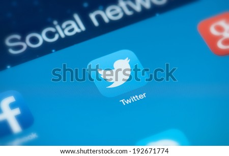 MOSCOW, RUSSIA - MAY 09, 2014: Twitter icon on screen. Twitter is an online social networking service that enables users to send short character text messages. - stock photo