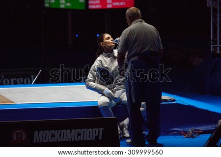 MOSCOW, RUSSIA - MAY 31 2015: Vasiliki Vougiouka just before finals on the World  fencing Grand Prix Moscow Saber in Luzhniki sport palace - stock photo