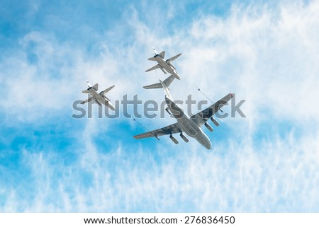 MOSCOW, RUSSIA - MAY 9, 2015. Victory Parade in Red Square to commemorate 70th anniversary of victory in the Great Patriotic war. IL-78 refueling tanker demonstrates in-flight refueling of  SU-24. - stock photo