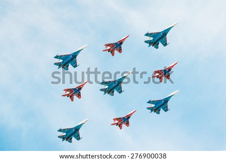 MOSCOW, RUSSIA - MAY 9, 2015. Victory Parade in Red Square to commemorate 70th anniversary of victory in the Great Patriotic war . Airshow. - stock photo