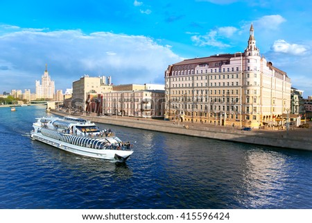 MOSCOW, RUSSIA - MAY 2, 2016: View of river with passenger boat, Raushskaya embankment, Baltschug Kempinski Hotel in Moscow. Russia.