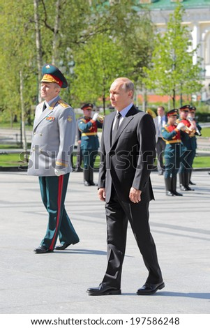 MOSCOW, RUSSIA - MAY 8, 2014: Vladimir Putin at the ceremony of laying flowers to the Tomb of the Unknown Soldier. Festive events dedicated to the 69th Anniversary of Victory Day (WWII) - stock photo
