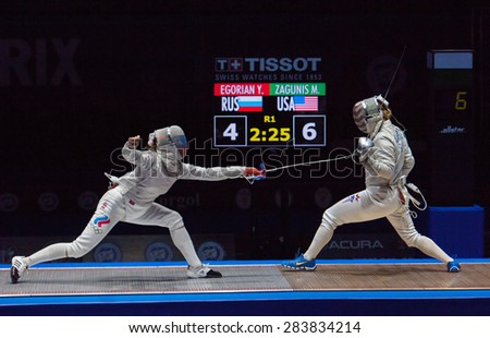 MOSCOW, RUSSIA - MAY 31 2015: Y. Egorian versus Mariel Zagunis on the World fencing Moscow Sabre Grand Prix in Luzhniki sport palace - stock photo