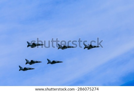 MOSCOW/RUSSIA - MAY 9: Yakovlev Yak-130 (Mitten) subsonic advanced jet trainer/light attack fighters of Tavrida Wings form Pyramid on parade devoted to Victory Day anniversary on May 9, 2015 in Moscow