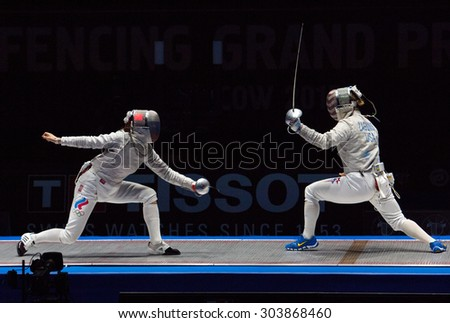 MOSCOW, RUSSIA - MAY 31 2015: Yana Egorian and Mariel Zagunis fights on the World  fencing Grand Prix Moscow Saber in Luzhniki sport palace - stock photo