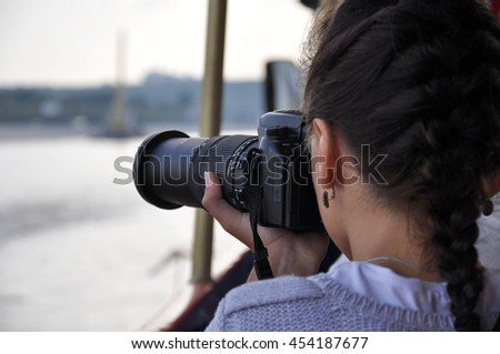 Moscow, Russia Moscow River, boat trip, cloudy, girl, photographer, August 18, 2012