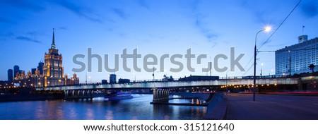Moscow, Russia, night landscape with Novoarbatsky bridge over the river - stock photo
