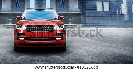 Moscow, Russia - November 22, 2015: Premium car Land Rover Range Rover standing near modern building in the city at daytime - stock photo