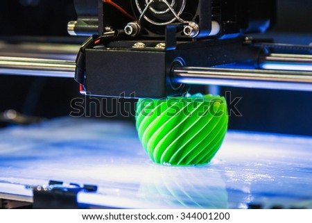 "Moscow, Russia, November 20, 2015: The 3rd International Exhibition of Robotics and advanced technologies ""Robotics Expo"" in Moscow. Focus on a green plastic - stock photo"