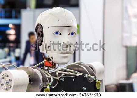 "Moscow, Russia, November 20, 2015: The 3rd International Exhibition of Robotics and advanced technologies ""Robotics Expo"" in Moscow. Focus on the head, soft focus - stock photo"