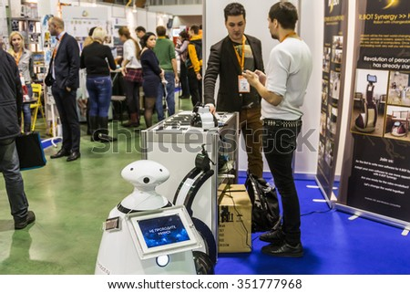 "Moscow, Russia, November 20, 2015: The 3rd International Exhibition of Robotics and advanced technologies ""Robotics Expo"" in Moscow. Focus on the plate in the robot, soft focus - stock photo"