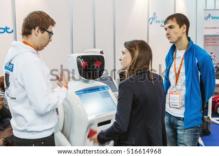 "Moscow, Russia, November 4, 2016: The 4rd International Exhibition of Robotics and advanced technologies ""Robotics Expo"" in Moscow.Visitors inspect the exposition of robots and new technologies"