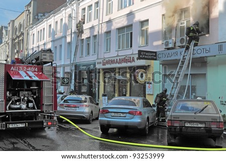 MOSCOW, RUSSIA - OCT 07: Firefighters extinguish a fire of the Pushechnaya Street on October 07, 2011 in Moscow.
