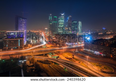 MOSCOW, RUSSIA - OCT 30, 2014: Night view of the city with Mirax-Plaza and Building of Moscow International Business Center (Moscow-City) - stock photo