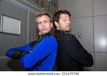 MOSCOW, RUSSIA, October 4: Actor Misha Collins and Comic Con attendee poses in the costume during Comic Con 2014 at The Crocus Center on October 4, 2014 in Moscow, Russia. - stock photo