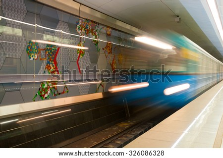MOSCOW, RUSSIA - OCTOBER 06, 2015: Arriving subway train at metro station Spartak in Moscow, Russia. Spartak was opened  August 27, 2014. - stock photo