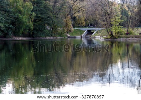 Moscow, Russia - October 12, 2015: Exhibition of achievements of national economy (VDNH). People walking near the pond.