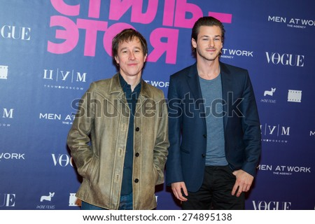 """MOSCOW, RUSSIA, October, 9: French actor Gaspard Ulliel and Bertrand Bonello attend the premiere of the movie """"Saint Laurent"""" on October, 9, 2014 at Octyabr Cinema in Moscow, Russia - stock photo"""