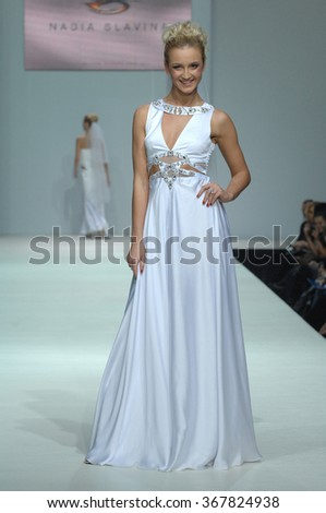 MOSCOW, RUSSIA - October 28, 2011: Moscow Fashion Week in Gostiny Dvor. Russian TV presenter Olga Buzova in the show of fashion designer Slavina - stock photo