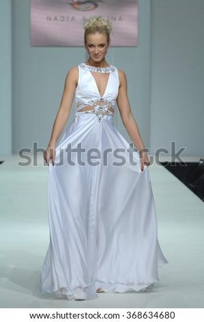 MOSCOW, RUSSIA - October 28, 2011: Moscow Fashion Week in Gostiny Dvor. Russian TV presenter Olga Buzova on the fashion show of Russian designer Nadejda Slavina - stock photo