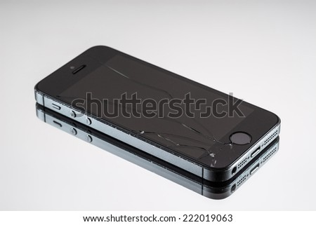 MOSCOW, RUSSIA - OCTOBER 6, 2014: Photo of a broken iPhone 5. iPhone 5 is a smartphone developed by Apple Inc. It is part of the iPhone line. iPhone is world favorite smartphone.