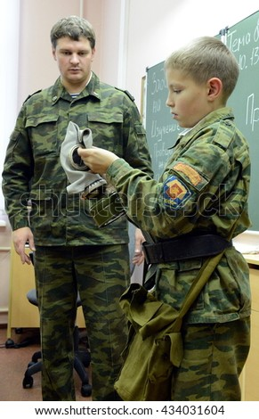 MOSCOW, RUSSIA - OCTOBER 24,2013:Training putting on the gas mask.Cadet corps - initial military training school with the full Board to prepare youth for a military career.