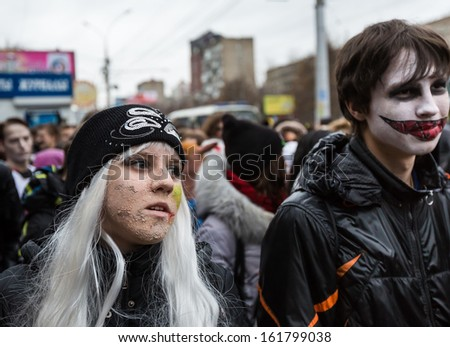 MOSCOW, RUSSIA - OCTOBER 31 Young people taking part in a zombie parade in the streets of Moscow, to celebrate Halloween. October 31, 2013 in Moscow, Russia.
