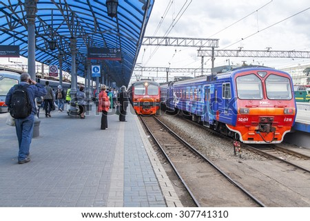 MOSCOW, RUSSIA, on AUGUST 19, 2015. The regional electric train stopped at a platform of the Yaroslavl station. Passengers go and stand on a platform