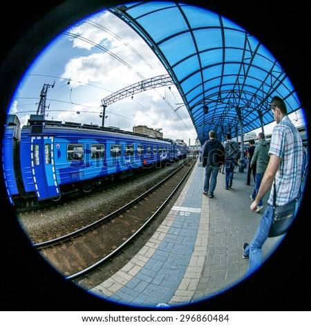 MOSCOW, RUSSIA, on JULY 15, 2015. The local train costs at the platform of the Yaroslavl station, passengers go on the platform, Fisheye view.  - stock photo