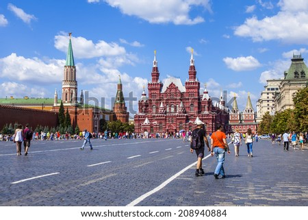 Moscow, Russia, on July 26, 2014. Tourists and citizens walk on Red Square in the sunny summer day. The Red Square is a main square of the city