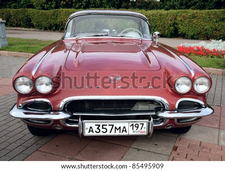 "MOSCOW, RUSSIA - SEPT 24: A 1962 Chevrolet Corvette  in the final stage of the competition for classic cars at the ""Closing  of the season Rally Retro Car"" on September 24, 2011 in Moscow, Russia - stock photo"