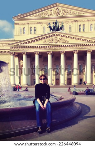 MOSCOW, RUSSIA - SEPT 19, 2014: Unidentified tourist in front of the Bolshoi Theatre. The theatre was built in 1821 - 1824. Filtered image in instagram style.                                 - stock photo