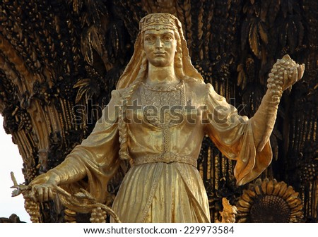 MOSCOW, RUSSIA - SEPT 20, 2014: Woman symbolizing Armenia - part of the fountain Friendship of Nations (1954), All Russian Exhibition Center - stock photo