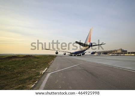 MOSCOW, RUSSIA - SEPTEMBER 26, 2014: Boeing 747 Transaero taxiing to the runway. Transaero Airlines has ceased to exist in 2015.