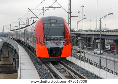 MOSCOW, RUSSIA - SEPTEMBER 11, 2016: Moscow Central Circle Line (Moscow Ring Railway). Modern high-speed train moves on a rail way. Opened to passengers on 10 September 2016