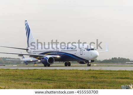 MOSCOW, RUSSIA - SEPTEMBER 26, 2014: Nordstar airlines Boeing-737 taxiing. Plane makes taxiing on taxiway Domodedovo International Airport. - stock photo