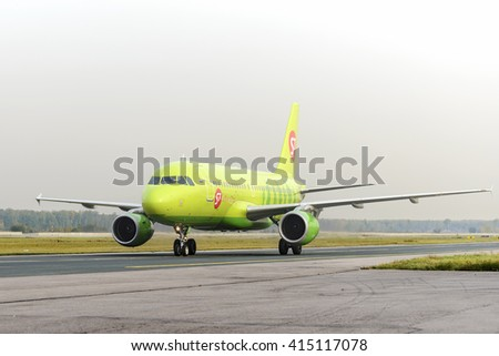 MOSCOW, RUSSIA - SEPTEMBER 26, 2014: S7 airlines Airbus A319 taxiing. Plane makes taxiing on taxiway Domodedovo International Airport. - stock photo