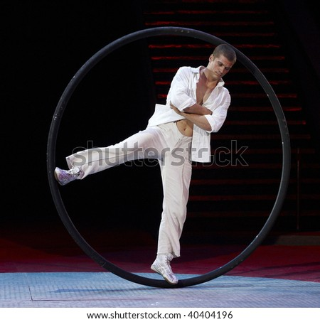 MOSCOW, RUSSIA - SEPTEMBER 03: The unknown young gymnast carries out show with hoop at Moscow International Circus Festival on September 03, 2009 in Moscow, Russia.