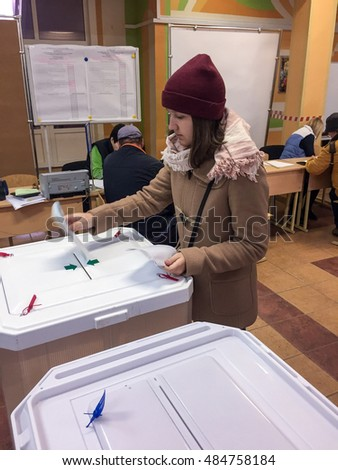 MOSCOW, RUSSIA - SEPTEMBER 18, 2016: The voter puts the ballot in the ballot box in the elections of deputies of the state Duma