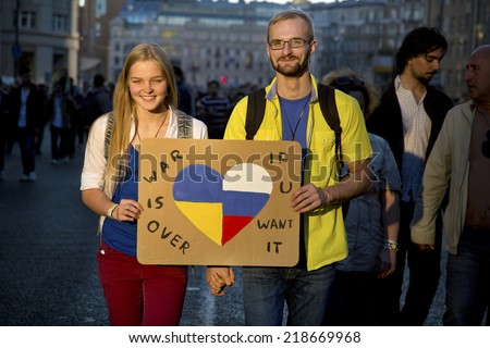MOSCOW, RUSSIA - SEPTEMBER 21: Thousands people marched against war in Ukraine in center of Moscow, September 21, 2014, Russia  - stock photo