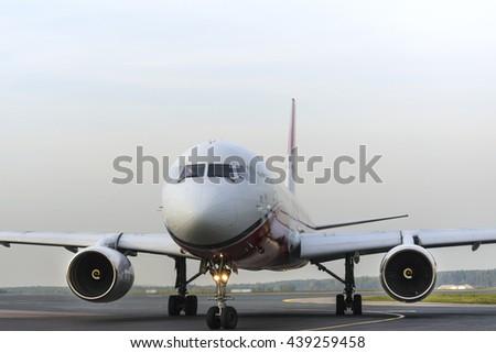 MOSCOW, RUSSIA - SEPTEMBER 26, 2014:  Tupolev Tu-204  Red Wings taxiing for take off at Domodedovo international airport - stock photo