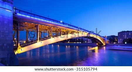 Moscow, Russia, summer evening cityscape with Smolensky Metro Bridge in illumination. Blurred motion, long exposure - stock photo