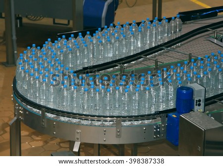 Moscow, Russian Federation - December 07, 2013: Water bottle conveyor industry. - stock photo