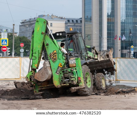 MOSCOW, RUSSIAN FEDERATION - JULY 15, 2016: The preparatory work before laying new paving slabs. Used excavator. Chistoprudny boulevard.