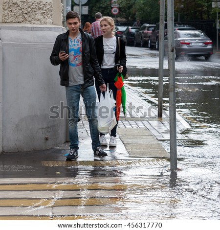 MOSCOW, RUSSIAN FEDERATION - JULY 20: Water on the road. The rain was very strong. It has poured a lot of water. Bolshoi Haritonievskiy Lane, 2016, Moscow, Russia.