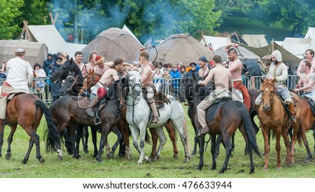 MOSCOW, RUSSIAN FEDERATION - JUNE 12, 2016: Ancient game in the bag with grass, an analogue of the modern rugby. Players on horseback. Historical reconstruction, Kolomenskoe Park.