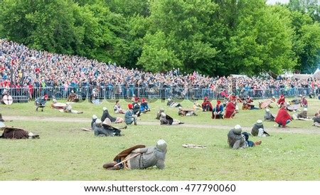 MOSCOW, RUSSIAN FEDERATION - JUNE 12, 2016: Each warrior sword fighting only for himself. Marshals in red hats monitor compliance with the rules. Historical reconstruction. Kolomenskoe Park.